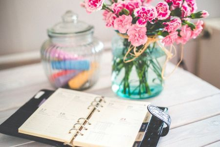 journal sitting next to bouquet of flowers