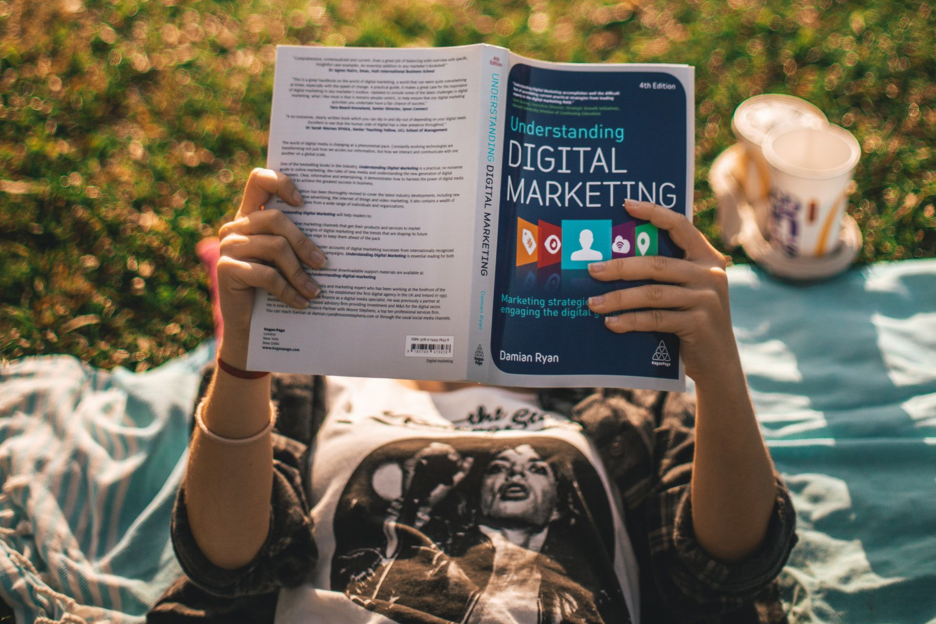 girl reading book about digital marketing