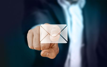 Man pointing at email icon