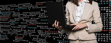 person standing in front of computer code