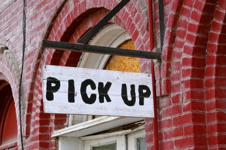 sign that reads pick up