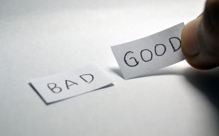 good and bad written on paper